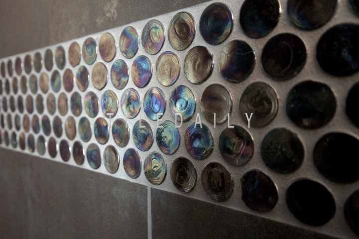 GM0012PE Purple Iridescent Penny Round Mosaic makes a great tile for accents, niches, and more. These can also be used on shower floors or other light traffic floors.