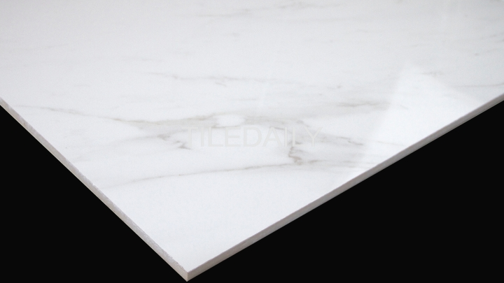 Glossy White Carrara Porcelain Tile now available at TileDaily. Features light veins.