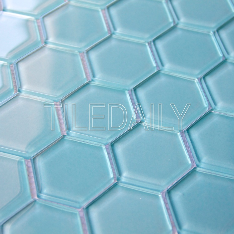 light turquoise blue hexagon glass mosaic wall tile and swimming pool waterline